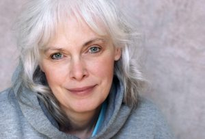 img-blog-Casual portrait of happy mature woman with natural white hair and minimal makeup