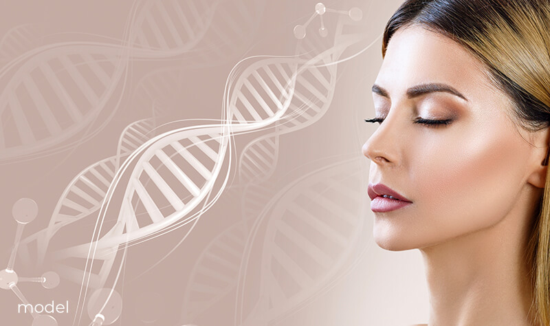 Young woman with her eyes closed in front of a DNA structure.