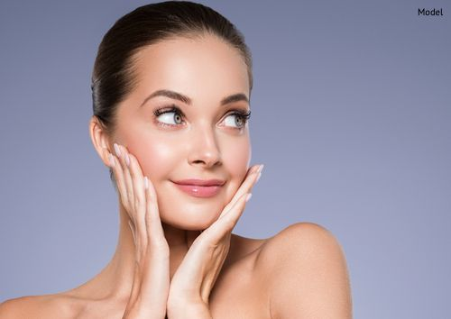 A woman enjoying the results of her facial rejuvenation treatment.